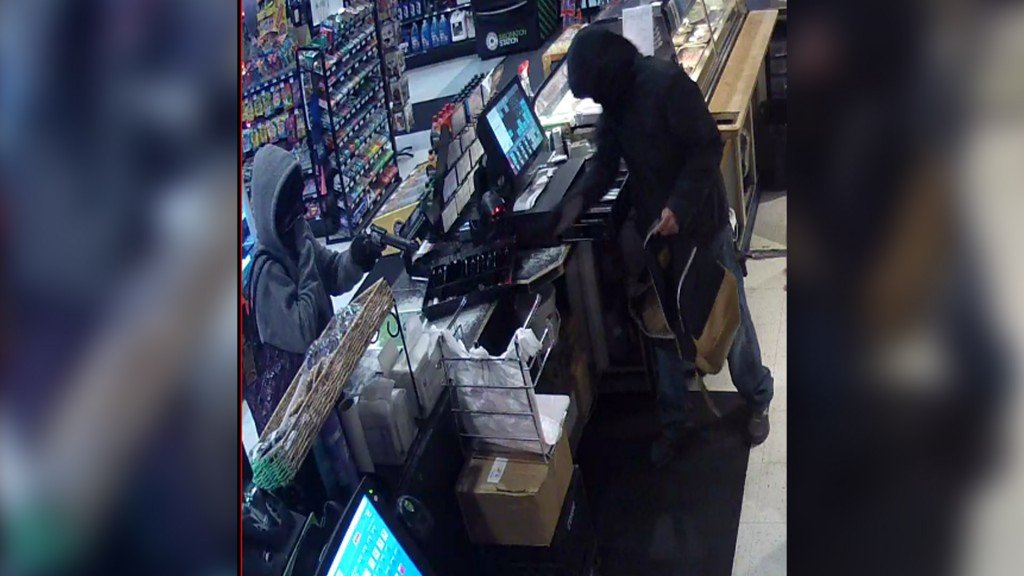 Suspects caught on surveillance cameras robbing a Superstop