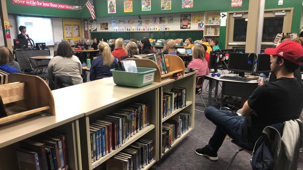 Teachers at Regal Elementary meet to prepare for a six-week school closure