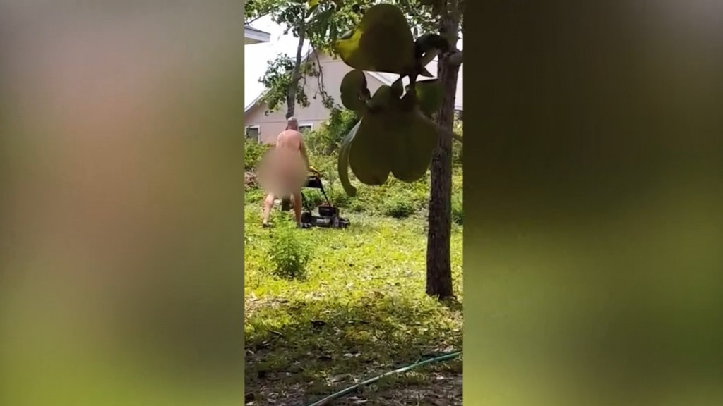 Teacher wants job back after he's caught mowing yard naked