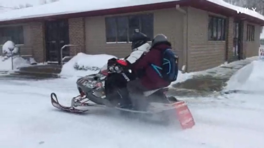 Michigan pharmacist uses snowmobile to deliver medicine