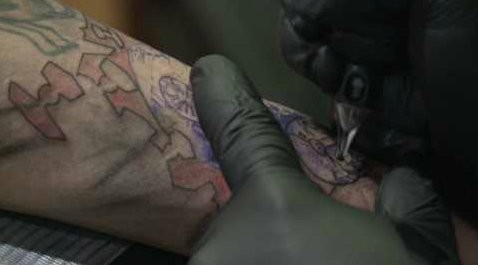 Scars from Virginia Beach shooting turn into tattoos for healing