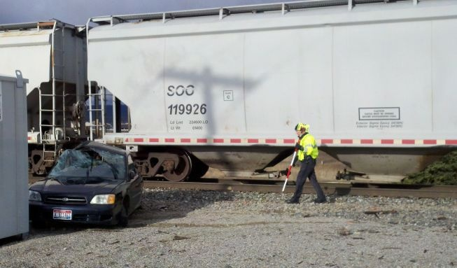 Driver hospitalized after train hits car near Post Falls