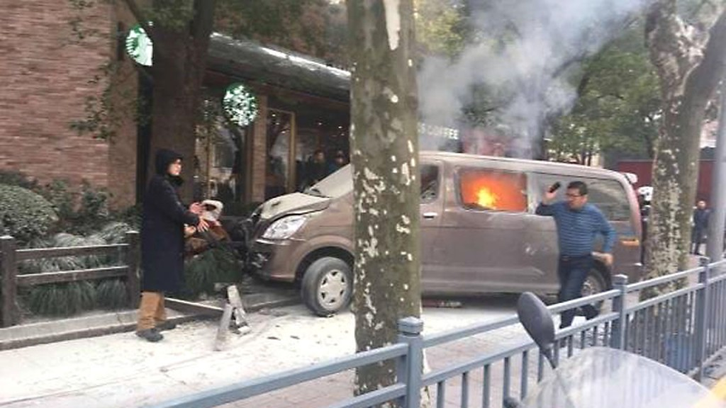 Vehicle catches fire, crashes into pedestrians in downtown Shanghai