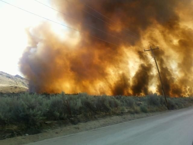 Central WA wildfire no longer threatening homes