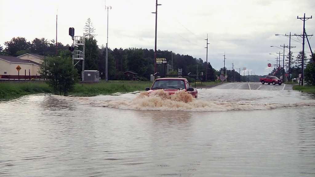 Floods wipe out roads, businesses in Michigan, Wisconsin