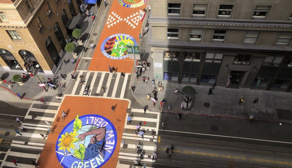 Climate activists paint murals on San Francisco streets