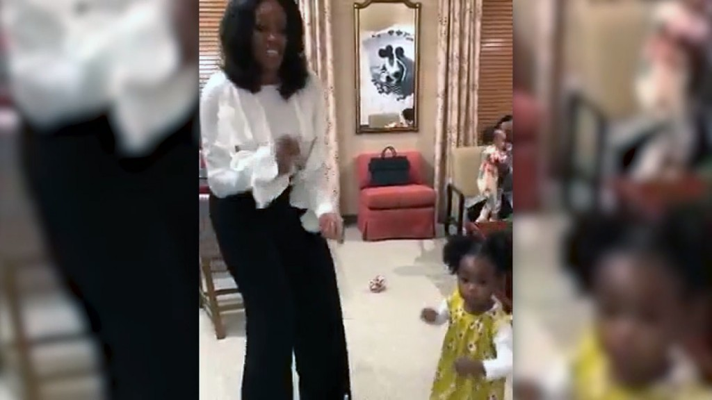 Michelle Obama dances with Parker Curry, her littlest fan