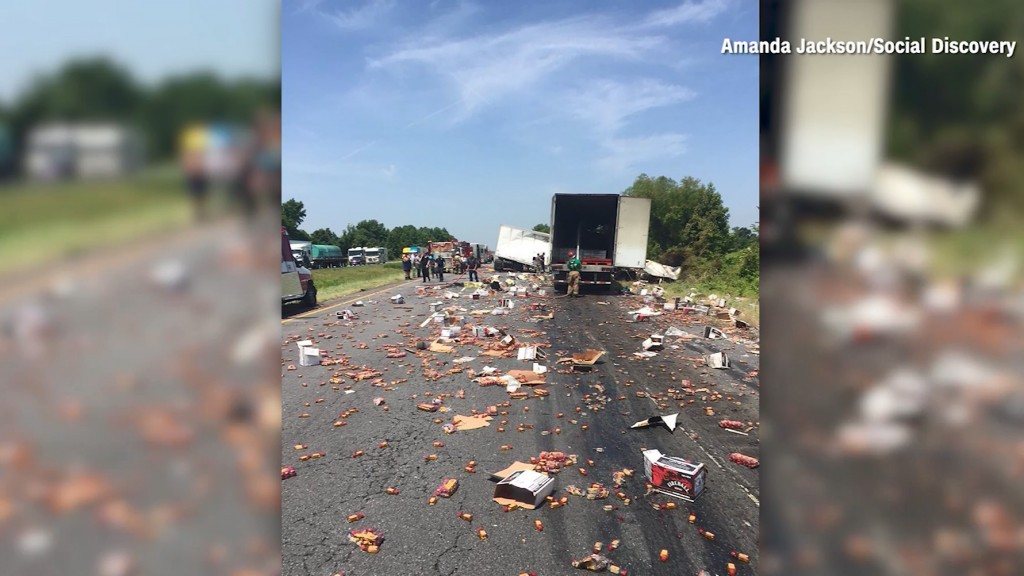 Truck collision leaves highway covered in whiskey