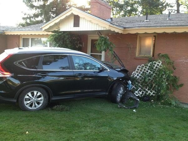 Car collides with car then collides with house