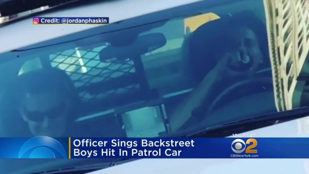 NYPD officer belts out Backstreet Boys over patrol car's PA system