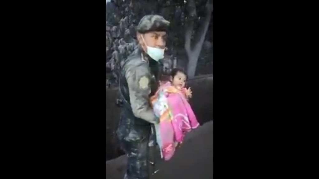 Baby rescued from volcano rubble reunited with family