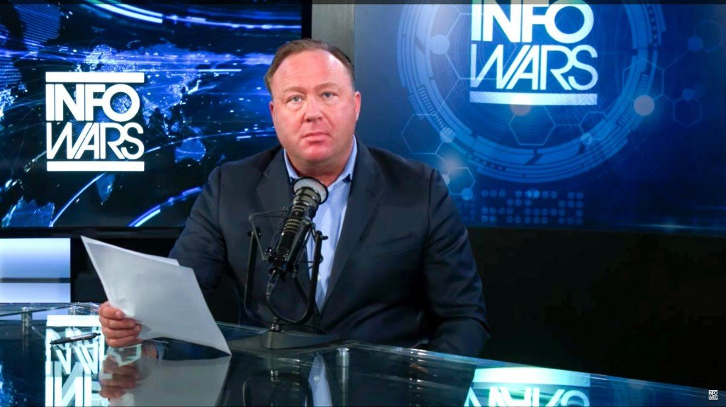 Alex Jones says 'form of psychosis' made him believe events like Sandy Hook massacre were staged