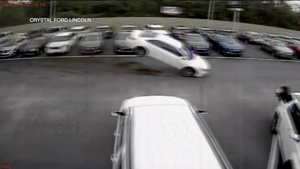 Out of control car flies over Florida dealership