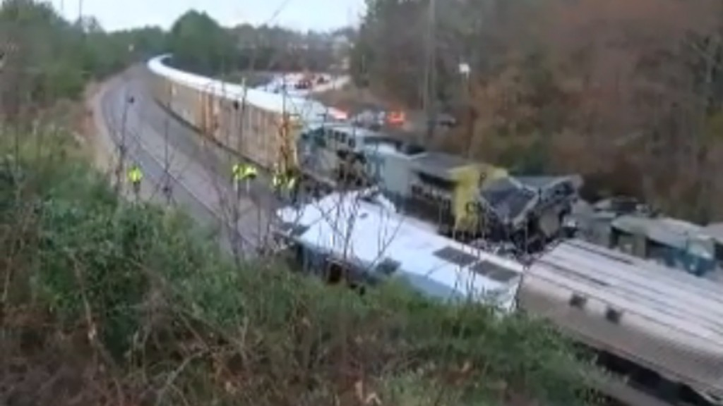 Two killed in crash involving Amtrak train, freight train