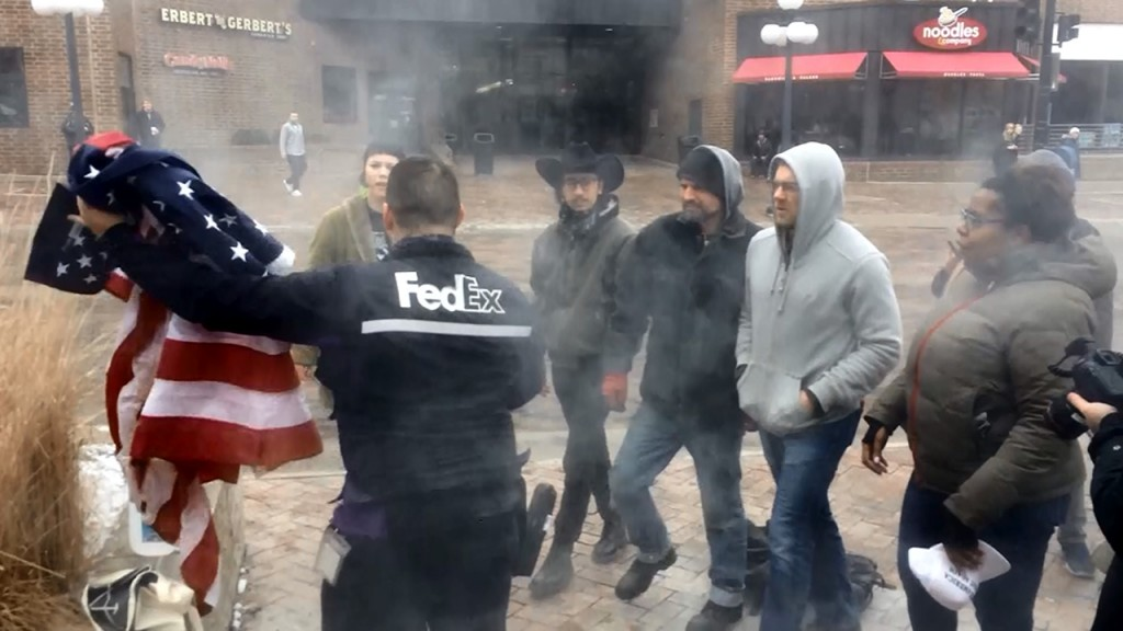 FedEx employee stops flag burning protest