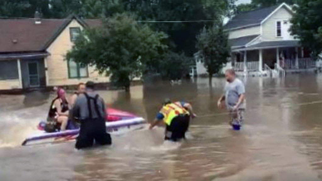 Woman refuses to leave home during flood, rescued on jet ski