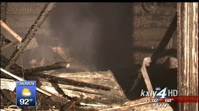 Woman injured in North Central garage fire