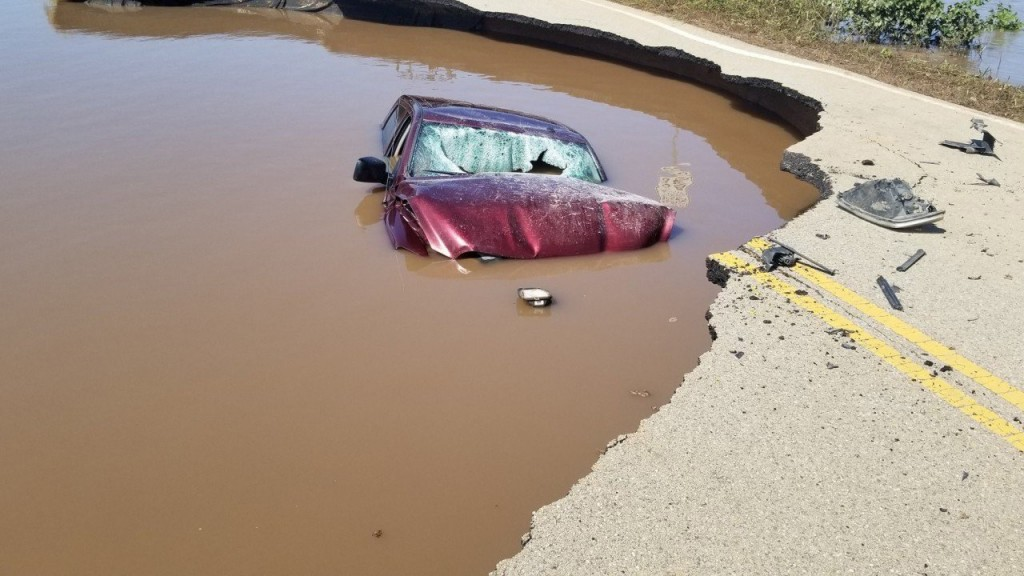 Driver ignores flood barricades, drives into sinkhole