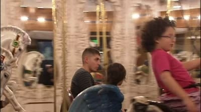 Local organization treats military families to carousel ride