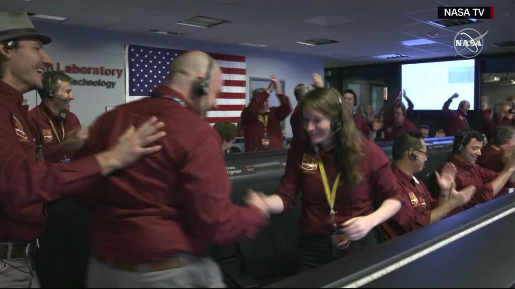 Epic NASA handshake inspired by NFL players