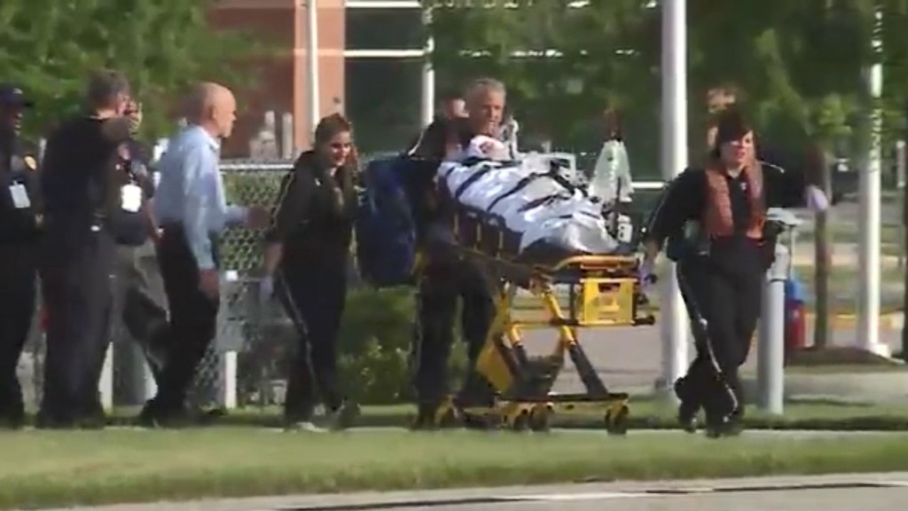 At least 12 dead after disgruntled employee opens fire at Virginia Beach municipal center