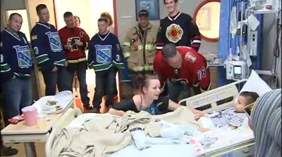 Cops, firefighters visit Children's Hospital before Guns and Hoses game