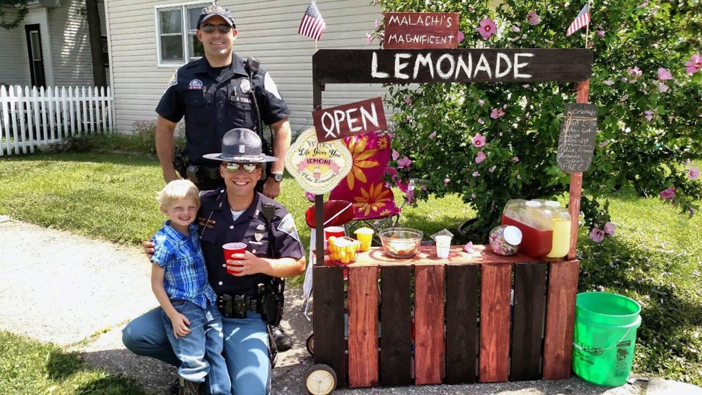 A 6-year-old boy's lemonade raises $7,000 for the family of a slain deputy