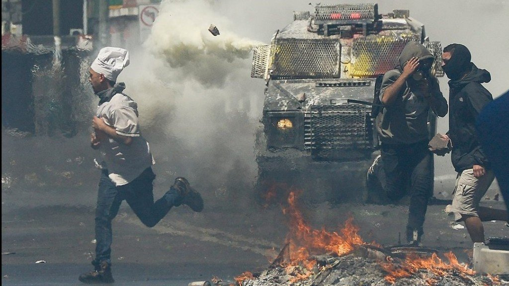 Chilean president asks ministers to resign after week of unrest