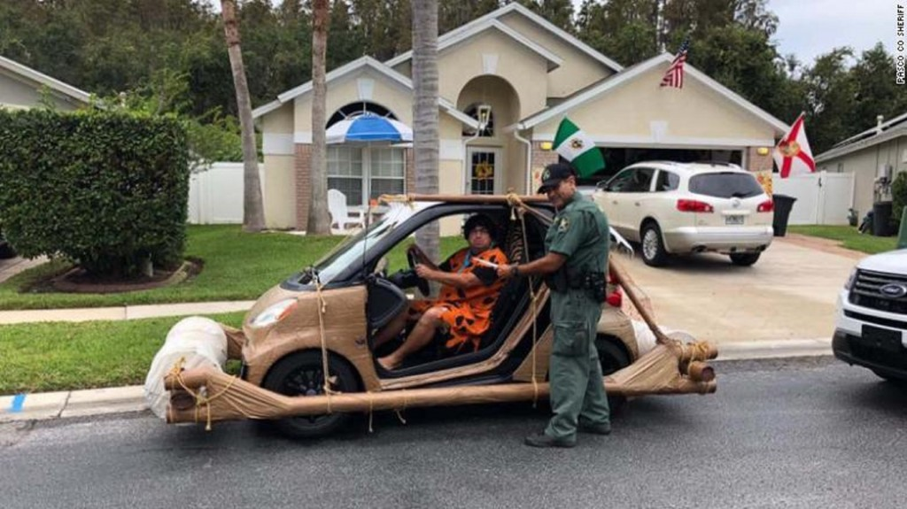 Florida man dressed as Fred Flintstone pulled over for driving 'footmobile'