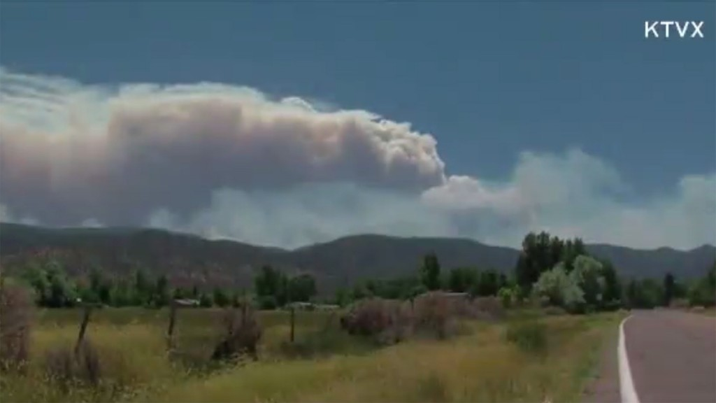 Wildfires blazing under extreme heat out West