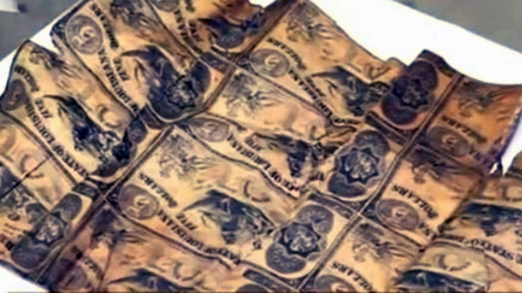 Flags, cash and medals found hidden inside a 1913 Confederate time capsule