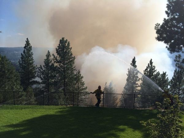 Brush fire encroaching on homes along High Drive on South Hill