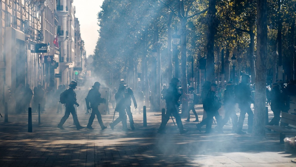 Paris police use tear gas to prevent yellow vest protests