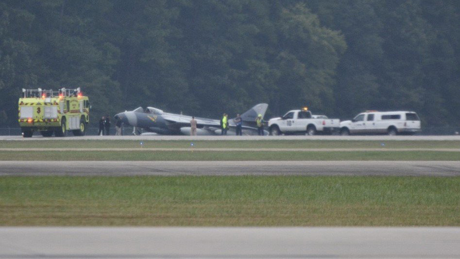 Military aircraft lands off runway at Virginia airport