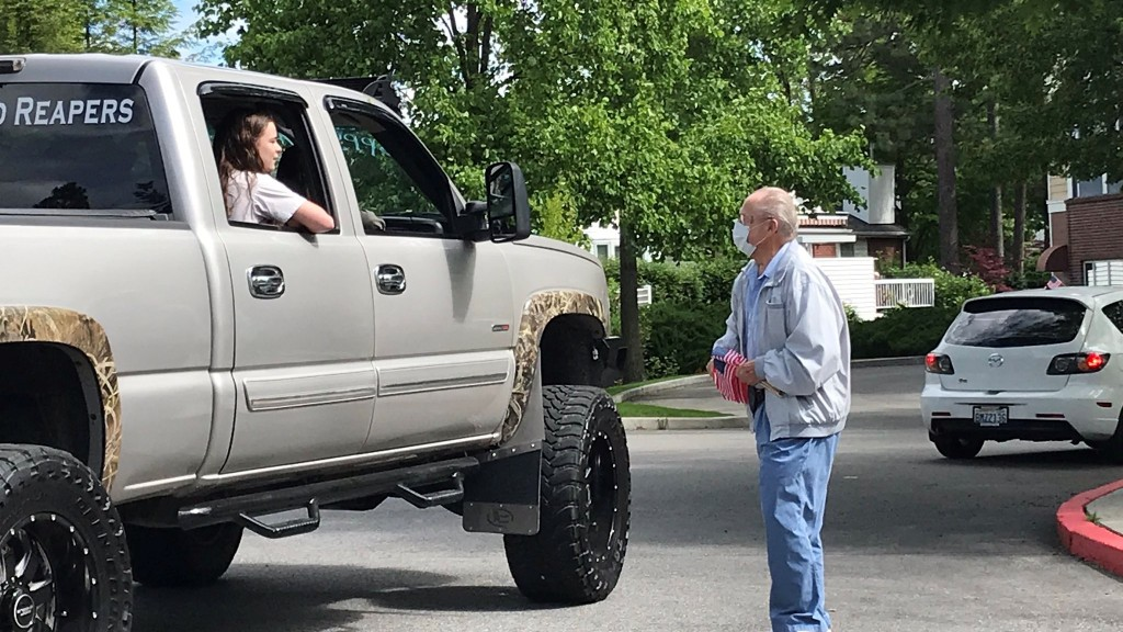 Families visit loved one for Father's Day with drive-by parade