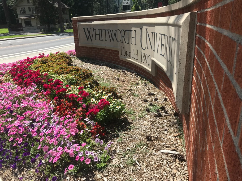 Whitworth Sign With Flowers