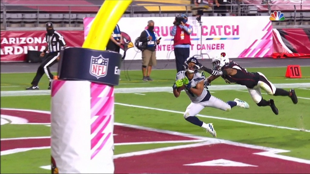 Seattle's Tyler Lockett pulls in a long touchdown pass from Russell Wilson