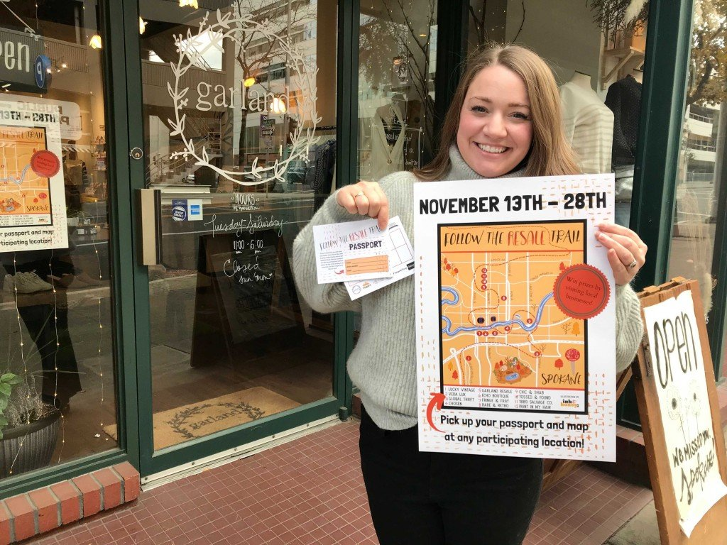 Owner Of Garland Resale With Event Flier