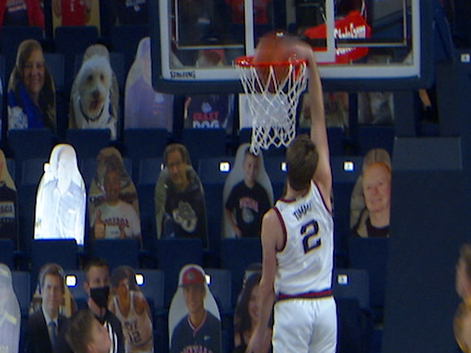 Gonzaga's Drew Timme dunks home two of his 14 points in a win against NAU.