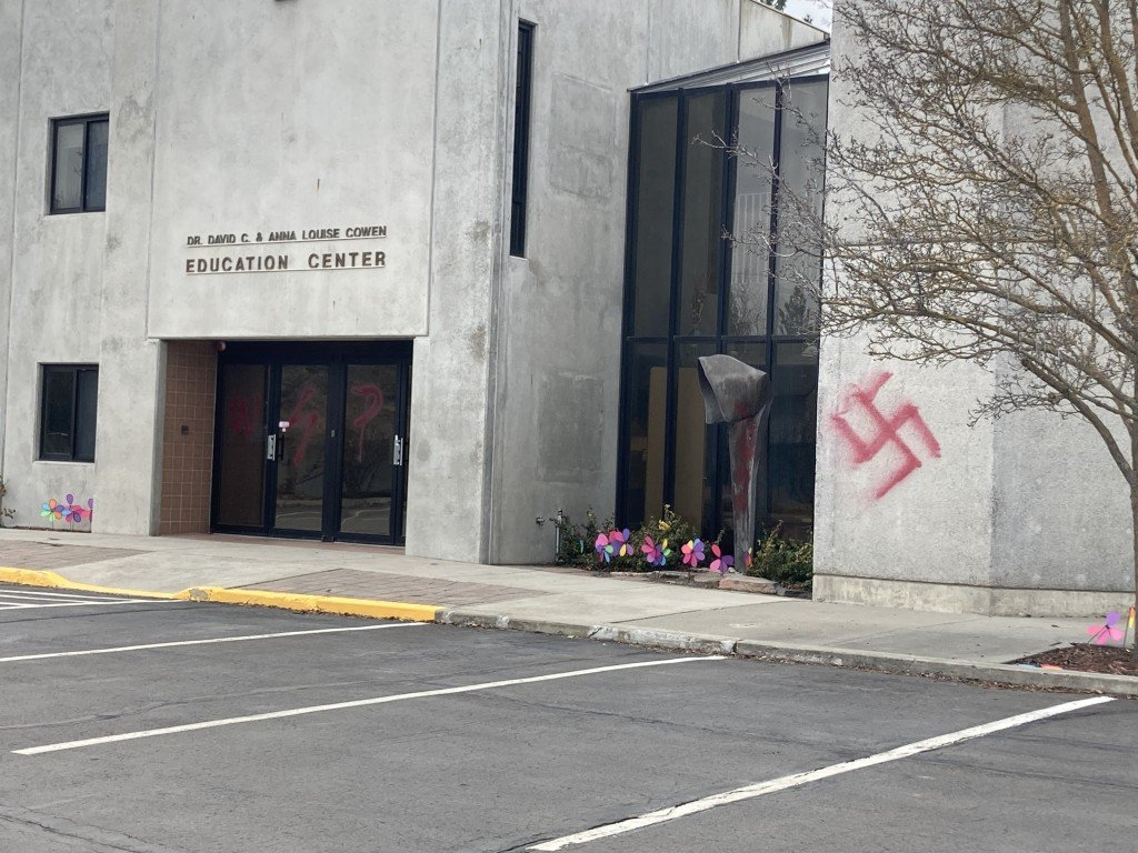 Community shows support for synagogue targeted by hate crime.
