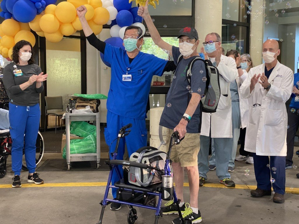 Greg Soumokil leaving the hospital with a Total Artificial Heart
