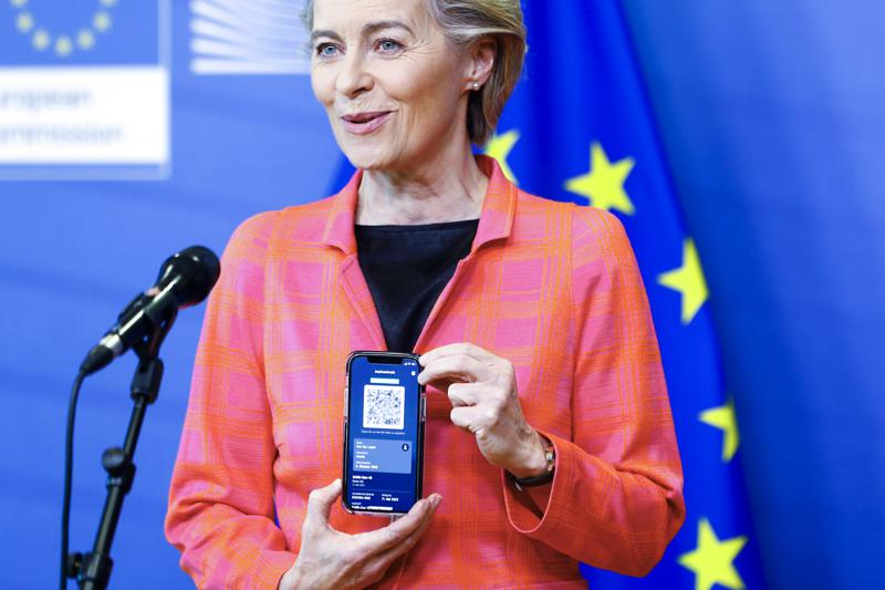 European Commission President Ursula von der Leyen shows her EU Digital Covid Certificate as she gives a press statement on the new COVID-19 digital travel certificate at the European Commission headquarters in Brussels, Wednesday, June 16, 2021. (Johanna Geron/Pool Photo via AP)