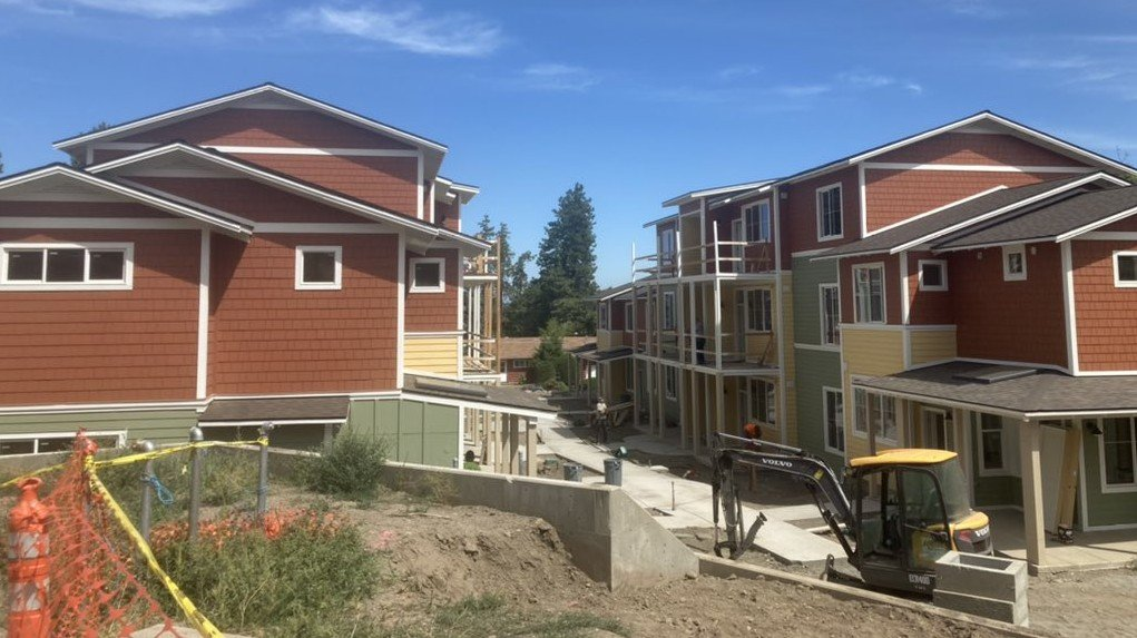 Families get ready to move into co-housing community.