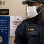 The Latest: Dc Reinstates Mandatory Indoor Mask Requirements