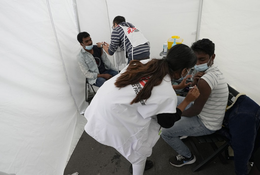 Aid Group Vaccinates Migrants As France Expands Virus Pass