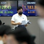 Asian Shares, Wall Street Hold Gains After Fed Statement