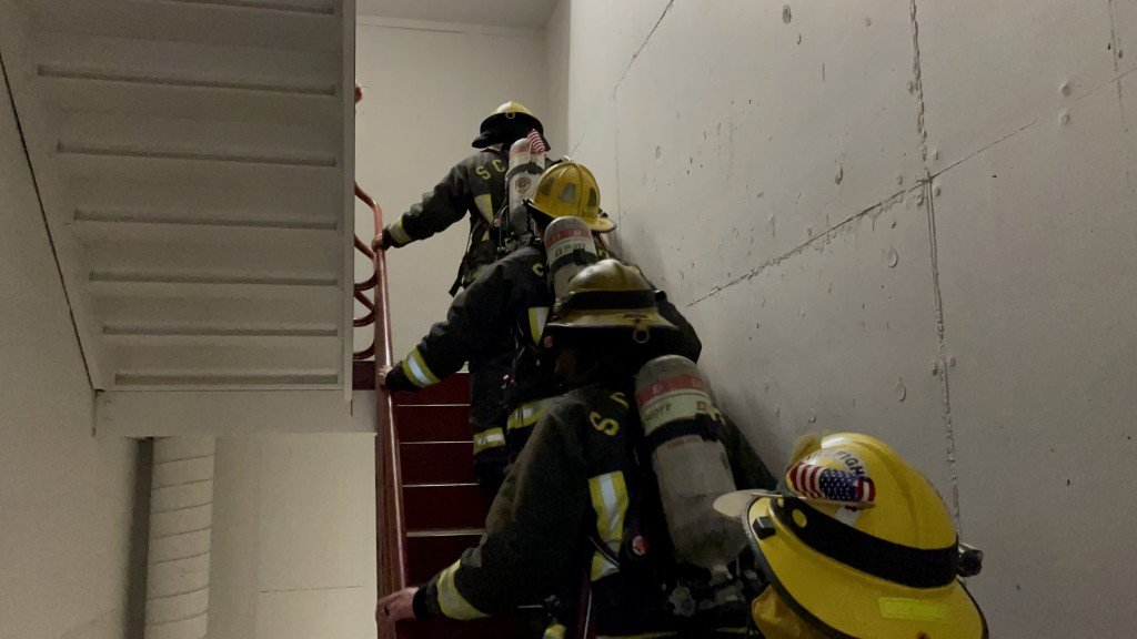 Spokane area firefighters climb the Bank of America building on the 20th anniversary of 9/11