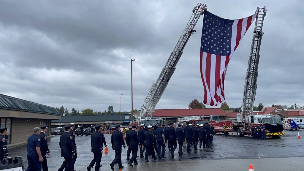 Firefighters Walk Under Ladder With Flag For Spokane Co Fire District 9s Lt Cody Trabers Funeral