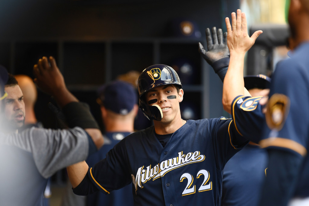 MILWAUKEE, WI – AUGUST 22: Christian Yelich #22 of the Milwaukee Brewers is congratulated by teammates following a home run against the Cincinnati Reds during the first inning of a game at Miller Park on August 22, 2018 in Milwaukee, Wisconsin. (Photo by Stacy Revere/Getty Images)
