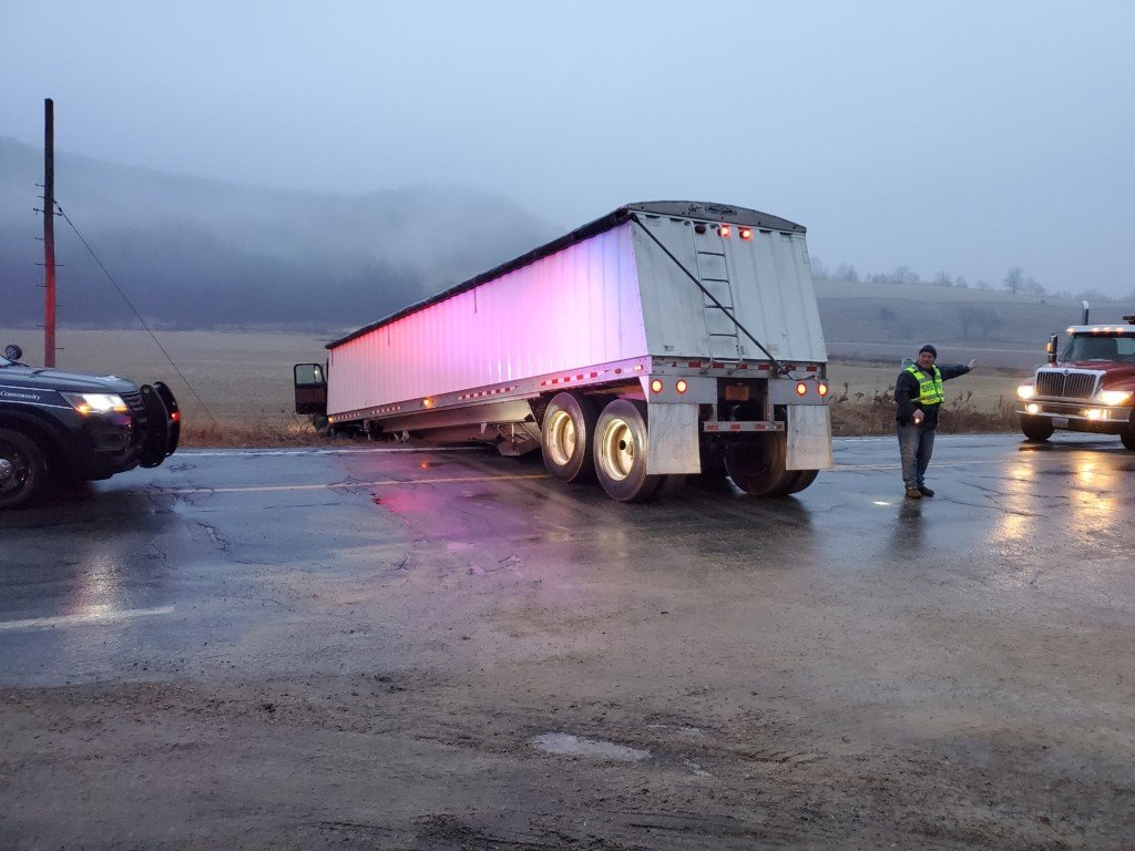 Semi slides through highway intersection early Tuesday morning